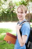 Young male student. Standing with backpack and books Stock Photography