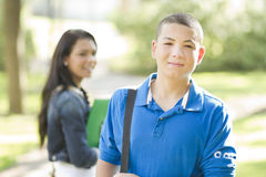 Young male student. A teenage male student outdoors looking at camera Stock Image