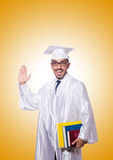 Young male student against the gradient. The young male student against the gradient Royalty Free Stock Photo