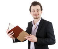 Young male student with calendar Royalty Free Stock Photography