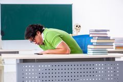The young male student in front of green board. Young male student in front of green board stock image