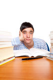 Young male student frustrated between study books Royalty Free Stock Photo