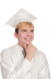 Young male student graduated from high school. On white stock photos