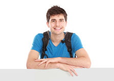 Young male student holding white blank board Stock Image