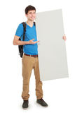 Young male student holding white blank board. Portrait of young male student holding white blank board Stock Image