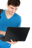 Young male student with laptop. Portrait of Young male student with laptop isolated over white background Stock Photography