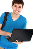 Young male student with laptop. Portrait of Young male student with laptop isolated over white background Royalty Free Stock Image
