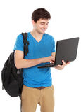 Young male student with laptop. Portrait of Young male student with laptop isolated over white background Royalty Free Stock Photo
