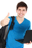Young male student with laptop showing thumb up. Portrait of Young male student with laptop showing thumb up isolated over white background Stock Photography