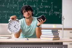 The young male student mathematician in front of chalkboard royalty free stock photos