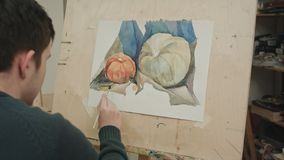 Young male student painting watercolor still life. Close up shot. Professional shot on BMCC RAW with high dynamic range. You can use it e.g. in your commercial Royalty Free Stock Image