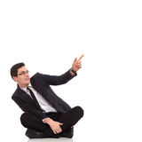 Young male student pointing at the air. Royalty Free Stock Photos