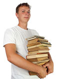 Young male student proudlyholding stack of books Royalty Free Stock Photo