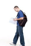 Young male student  studying. Young male student walking to school and studying Royalty Free Stock Photo