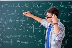 The young male student studying math at school. Young male student studying math at school stock photography