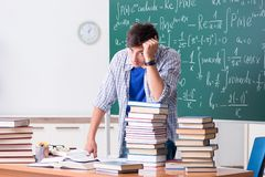 The young male student studying math at school. Young male student studying math at school royalty free stock images