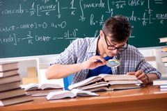 The young male student studying math at school. Young male student studying math at school royalty free stock photo