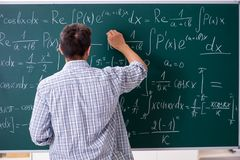 The young male student studying math at school. Young male student studying math at school royalty free stock photography