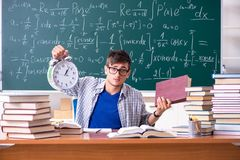 The young male student studying math at school. Young male student studying math at school stock photos