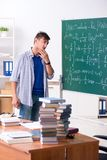 The young male student studying math at school. Young male student studying math at school royalty free stock photos