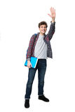 Young male student waving his hand Royalty Free Stock Image