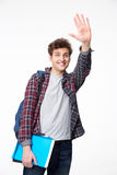 Young male student waving his hand Stock Photo