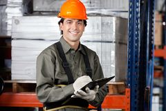 Young Male Supervisor With Clipboard Smiling Stock Photo