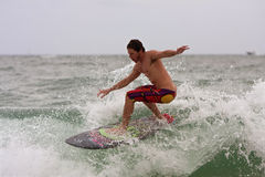 Young Male Surfs Wave Off Florida Coastline Royalty Free Stock Images