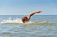 Young male swimming Royalty Free Stock Photo