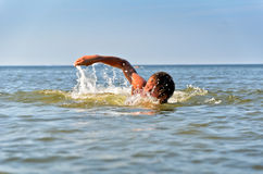 Young male swimming Royalty Free Stock Photography