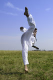 Young male taekwondo fighter attacking Royalty Free Stock Photo