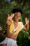 Young Male Tahitian Dancer. TAHITI - SEPTEMBER 16: Young male Tahitian dancer dressed in traditional Polynesian attire, performs for a private group of tourists Stock Photography
