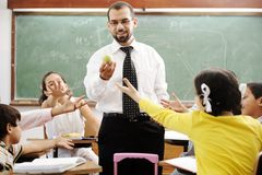 Young male teacher with children stock images