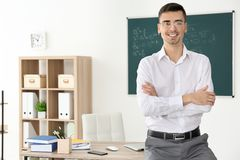 Young male teacher. In classroom Royalty Free Stock Photography