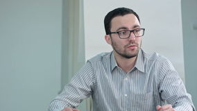 Young male teacher talking in classroom. Close up. Professional shot in 4K resolution. 075. You can use it e.g. in your commercial video, business stock video