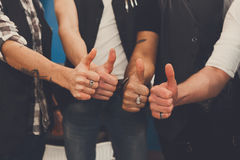 Young male team show thumb up sign Royalty Free Stock Photo