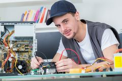 Young male tech tests electronic equipment Stock Images