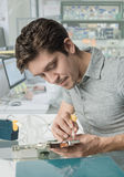 Young male tech works in in research facility Stock Photos
