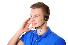Young male technical support dispatcher. On white background royalty free stock photography