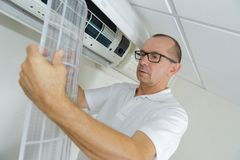Girl with air conditioning stock photo. Image of fashion