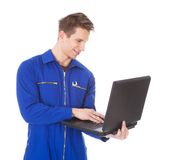 Young male technician using laptop. Over White Background Royalty Free Stock Photo