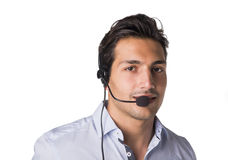 Young male telemarketer or call center operator. Young male telemarketer or support center receptionist with headset, isolated on white Royalty Free Stock Images