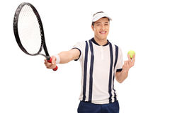 Young male tennis player holding. Young tennis player holding a racket and a ball isolated on white background Royalty Free Stock Images