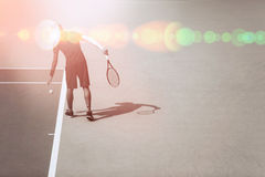 Young male tennis player at the tennis court Royalty Free Stock Image