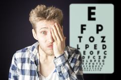Young male test eye vision and cover eye with hand b stock photography