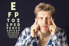 Young male test eye vision and cover eye with hand b stock photo