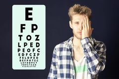 Young male test eye vision and cover eye with hand b royalty free stock images