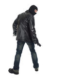 Young male thief in balaclava. And black leather jacket Royalty Free Stock Photo