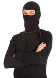 Young male thief in balaclava. With crossed arms, white background Royalty Free Stock Images
