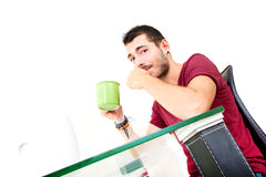 Young male thinking in the office Stock Photos